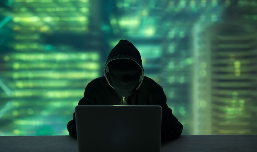 Computer security hacker on a laptop